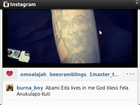 Burna Boy wears tatoo of Fela Face on his arm