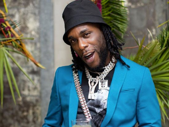 Burna Boy flaunts his Jewellery collection as he cleans them