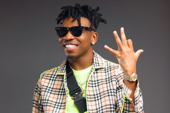 Mayorkun reacts as lady tattoos his face on her stomach