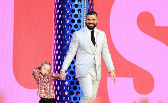 Drake accepts the Billboard Music Awards Artist of the Decade award with his son Adonis onstage.